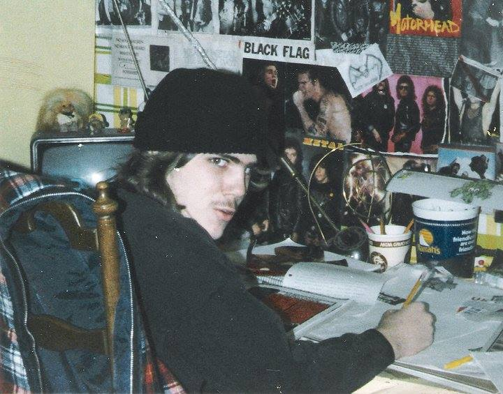 Chris Dowgin in teens drawing at desk