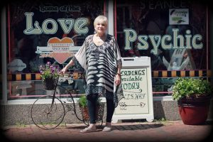 Rev barbara the Salem Love Psychic in front of her shop Angelica of the Angels